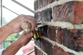 Mason Robert Hall points bricks by putting new mortar in the joints after the bad has been removed. After finishing a forensic assessment, exterior work is in process on the James Brice House in Annapolis to restore the brick Georgian mansion. Restoration of the building is continuing even as Historic Annapolis properties are closed.(Paul W. Gillespie / Capital Gazette)