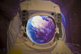 Space Travel: Apollo and Beyond The Earth is seen on a backdrop behind a cutout of an astronaut at Space Travel: Apollo and Beyond, hosted by Historic Annapolis at Maryland Hall in Annapolis. (Joshua McKerrow/Capital Gazette)