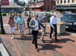 Mayor Gavin Buckley leads a tour of City Dock. Dr. Tim Chapin, who is giving a lecture on reimagining City Dock later in the day, speaks to a group of Annapolis City officials and business leaders at