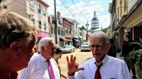 Joe Riley, former mayor of Charleston, S.C., talks with state Sen. Ed Reilly during a tour Tuesday night of downtown Annapolis with Historic Annapolis president Robert Clark and others. (Rick Hutzell/